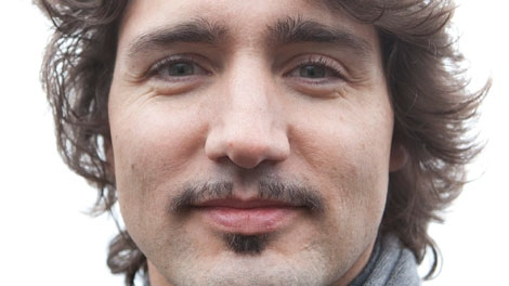 Liberal MP Justin Trudeau shows off his mustache on Parliament Hill in Ottawa on Tuesday, November 30, 2010. Trudeau grew a moustache for the