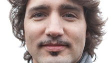 "Liberal MP Justin Trudeau shows off his mustache on Parliament Hill in Ottawa on Tuesday, November 30, 2010. Trudeau grew a moustache for the ""Movember"" awareness campaign about prostate cancer. THE CANADIAN PRESS/Pawel Dwulit"