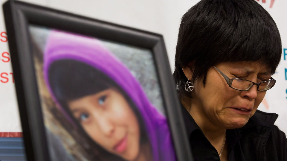 "A photograph of Summer ""CJ"" Morningstar Fowler, of the Gitanmaax First Nation near Hazelton, B.C., is displayed as her mother Matilda Fowler weeps during a news conference in Vancouver, B.C., on Wednesday, Dec. 12, 2012. . (Darryl Dyck / THE CANADIAN PRESS)"
