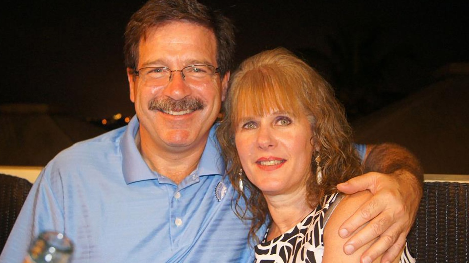 In this undated photo, Mark Sherlach and his wife, school psychologist Mary Sherlach, pose for a photo. Mary Sherlach was killed Friday, Dec. 14, 2012, when a gunman opened fire at Sandy Hook Elementary School, in Newtown, Conn., killing 26 children and adults at the school. (AP / Courtesy of Mark Sherlach