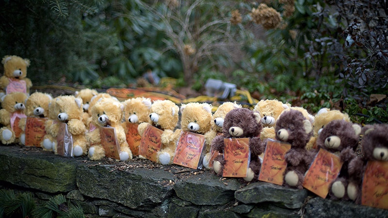 Teddy bears, each representing a victim of the Sandy Hook Elementary School shooting, sit on a wall at a sidewalk memorial in Newtown, Conn., on Sunday, Dec. 16, 2012.  (AP / David Goldman)