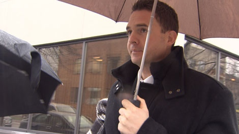 Former Vancouver police officer Peter Hodson leaves Vancouver provincial court after pleading guilty to trafficking marijuana and breaching the public trust. Nov. 30, 2010. (CTV)