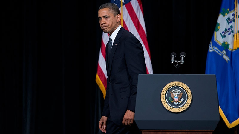 U.S. President Barack Obama walks off after delivering a speech at an interfaith vigil for the victims of the Sandy Hook Elementary School shooting on Sunday, Dec. 16, 2012 at Newtown High School in Newtown, Conn. (AP / Evan Vucci)