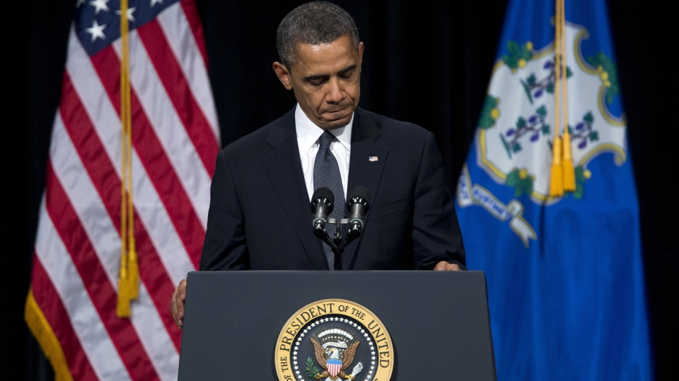 U.S. President Barack Obama pauses during a speech at an interfaith vigil for the victims of the Sandy Hook Elementary School shooting on Sunday, Dec. 16, 2012. (AP / Evan Vucci)