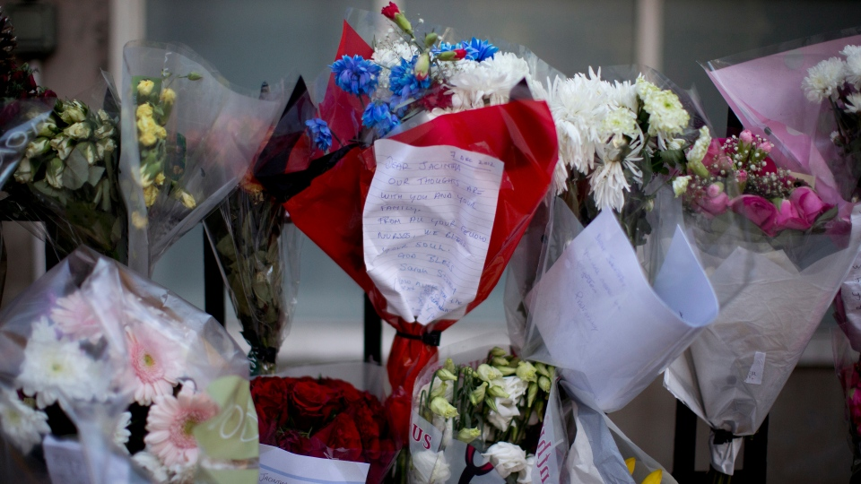 Floral tributes in memory of nurse Jancintha Saldanha are seen outside the accommodation block where she was found hanged near King Edward VII's Hospital in London, Monday, Dec. 17, 2012. (AP Photo/Matt Dunham)