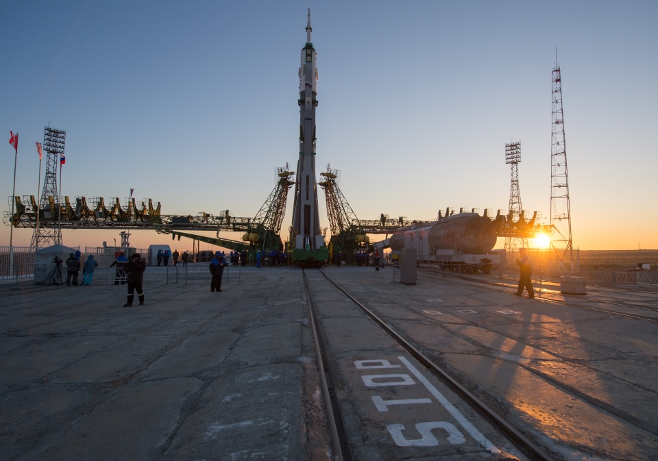 In this photo provided by NASA, the Soyuz rocket is erected into position after being rolled out to the launch pad by train at the Baikonur Cosmodrome in Kazakhstan on Dec. 17, 2012. (AP / NASA / Carla Cioffi)