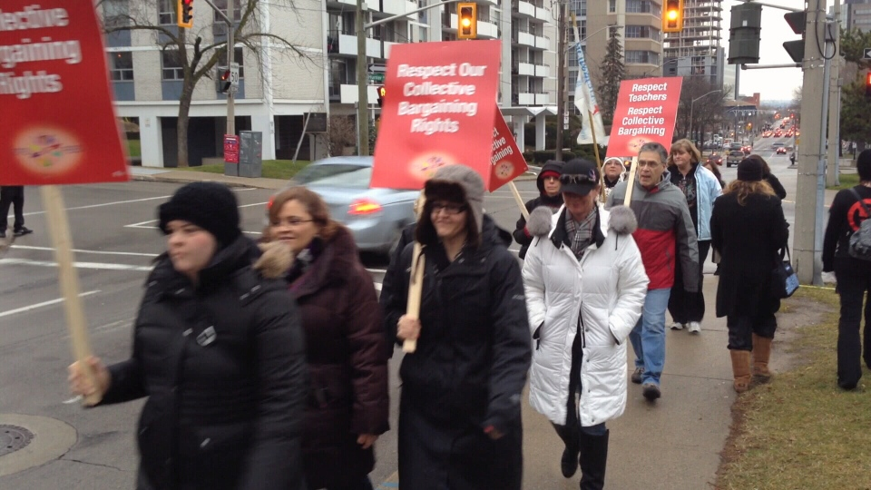 Teachers walk the picket line in Hamilton, Ont., on Monday, Dec. 17, 2012.