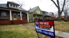 A home with a reduced price is shown in a once vibrant city of Windsor, Ont., in this January 2012 file photo. (Nathan Denette/THE CANADIAN PRESS)