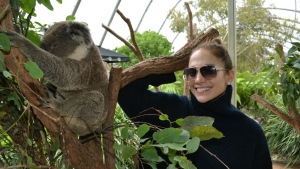 In this photo taken on Saturday, Dec. 15, 2012 and released by Wild Life Sydney Zoo on Monday, Dec. 17, 2012, singer and actress Jennifer Lopez stands next to a koala in Sydney Australia. Lopez was in Sydney for a concert performance at the Allphones Arena. (AP Photo/Wild Life Sydney Zoo)