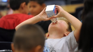 A Grade 2 student in Abilene, Texas, drinks his milk during lunch in this 2011 file photo. (AP Photo/Abilene Reporter-News/Nellie Doneva)