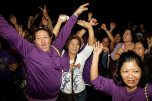 Filipino women celebrate as Philippine legislators pass a landmark law that would provide government funding for contraceptives and sexuality classes at the Philippine Congress in suburban Quezon City, north of Manila, Philippines on Monday, Dec. 17, 2012. (AP Photo/Aaron Favila)