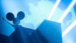 Deadmau5, left, performs at the Juno Awards on Sunday, April 1, 2012. (AP Photo/Arthur Mola)