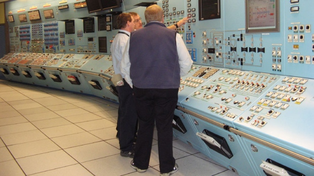 Workers from NB Power examine gauges in a control room simulator at the Point Lepreau nuclear power station on Monday Nov. 29, 2010, in Lepreau, N.B. (THE CANADIAN PRESS/ Kevin Bissett)