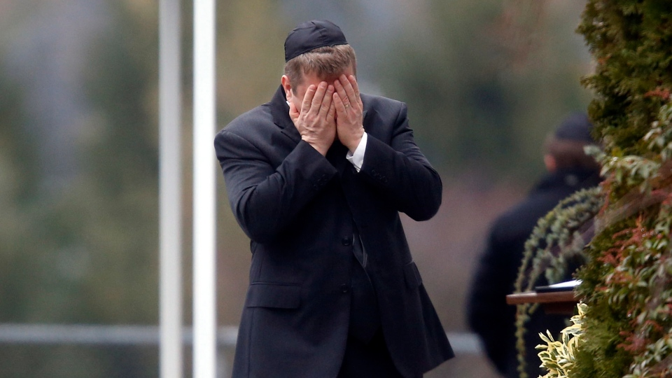A mourner arrives at the funeral service for 6-year-old Noah Pozner, Monday, Dec. 17, 2012, in Fairfield, Conn. Pozner was killed when a gunman walked into Sandy Hook Elementary School in Newtown Friday and opened fire, killing 26 people, including 20 children. (AP / Jason DeCrow)