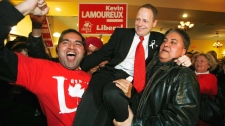 Liberal candidate Kevin Lamoureux celebrates his win over Kevin Chief from the NDP in the Winnipeg North by-election in Winnipeg, Monday, November 29, 2010. (John Woods / THE CANADIAN PRESS)