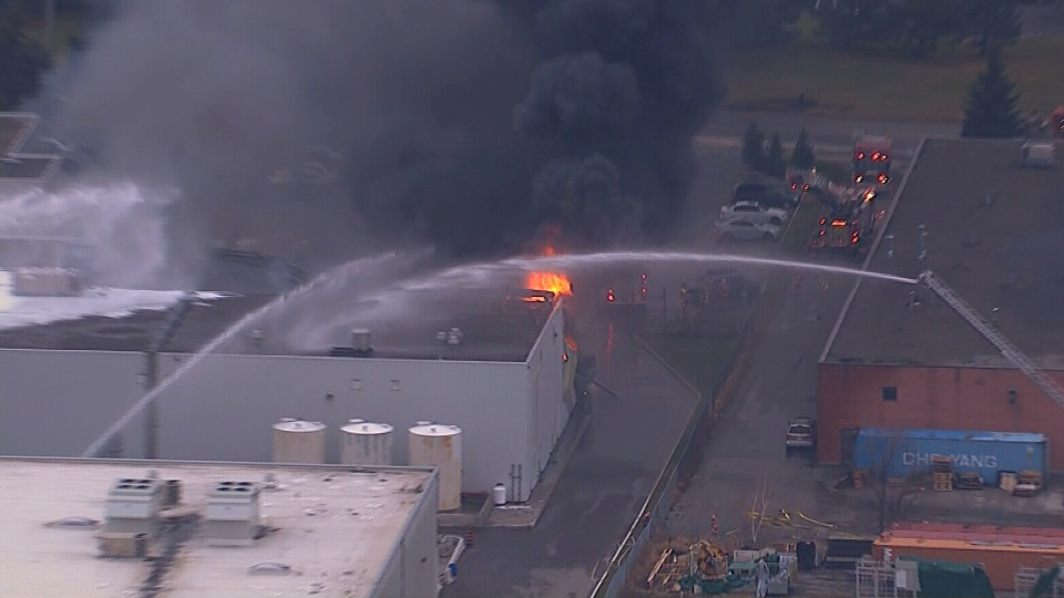 Firefighters douse flames at a major factory fire in Brampton on Monday, Dec. 17, 2012.
