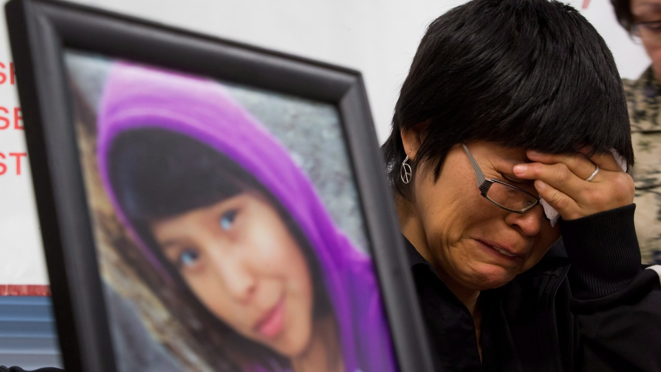 A photograph of Summer 'CJ' Morningstar Fowler, of the Gitanmaax First Nation near Hazelton, B.C., is displayed as her mother Matilda Fowler weeps during a news conference in Vancouver, on Wednesday, Dec. 12, 2012. (Darryl Dyck / THE CANADIAN PRESS)