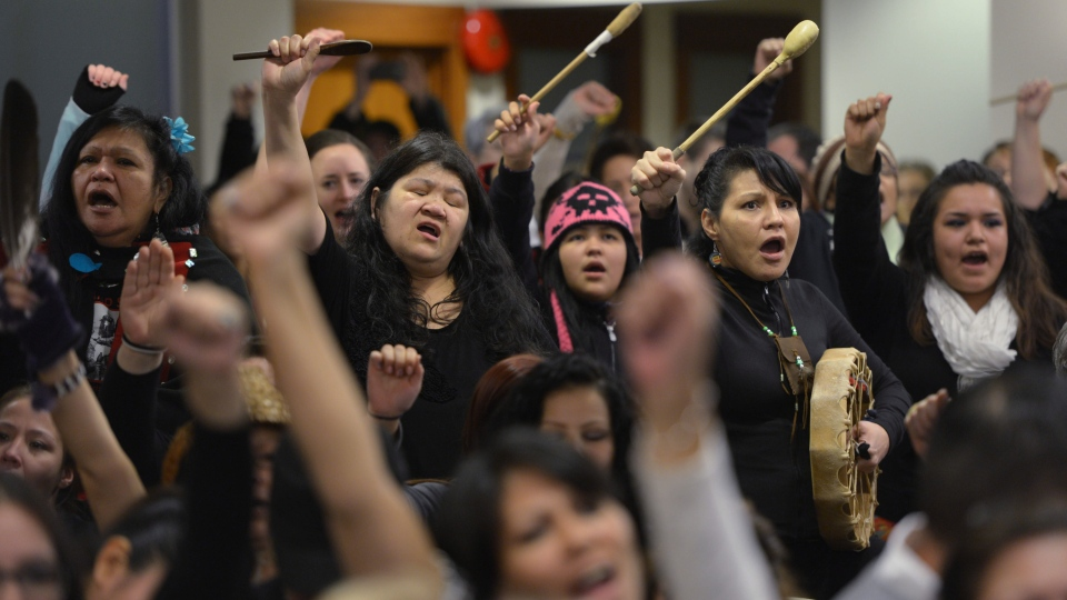 People react as Commissioner Wally Oppal delivers the final report of the Missing Women Inquiry in Vancouver, Monday, Dec. 17, 2012. (Jonathan Hayward / THE CANADIAN PRESS)