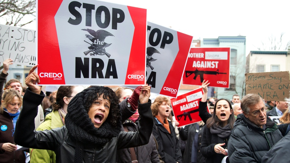 Tasha Devoe, left, of Lawrence, Mass., joins a march to the National Rifle Association headquarters on Capitol Hill in Washington Monday, Dec. 17, 2012. (AP / Manuel Balce Ceneta)
