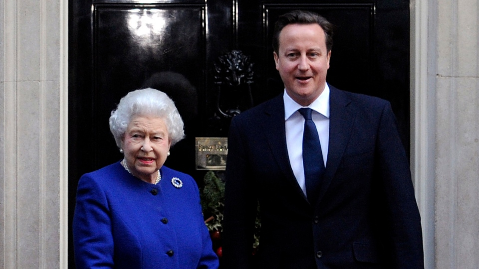 Queen Elizabeth II, left, is met by British Prime Minister David Cameron prior to attending a Cabinet meeting at 10 Downing Street, London, Tuesday, Dec. 18, 2012. (PA / Stefan Rousseau)
