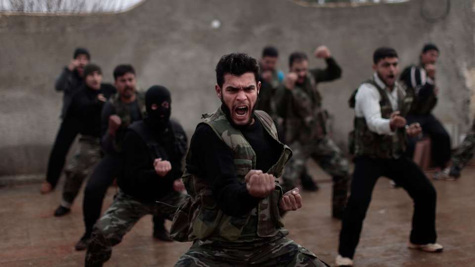 Syrian rebels attend a training session in Maaret Ikhwan, near Idlib, Syria Monday, Dec. 17, 2012. The training is part of an attempt to transform the rag-tag rebel groups into a disciplined fighting force. (AP / Muhammed Muheisen)