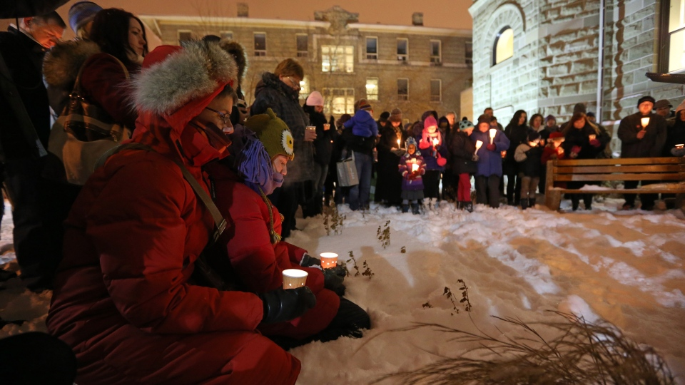 Friends, colleagues, and supporters attend a vigil in memory of six year-old Ana Marquez-Greene, a victim of Friday's mass shooting in Newtown, Conn., on Dec. 17, 2012. (THE CANADIAN PRESS / Trevor Hagan)