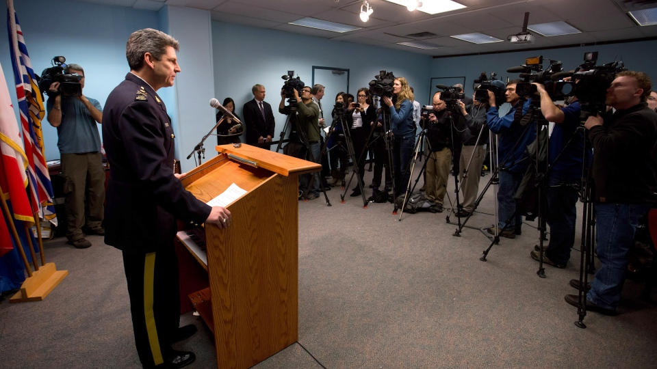 RCMP Deputy Commissioner Craig Callens, the Commanding Officer of the RCMP in British Columbia, reads a very brief statement in response to Commissioner Wally Oppal's inquiry report into serial killer Robert Pickton. (Darryl Dyck/THE CANADIAN PRESS)