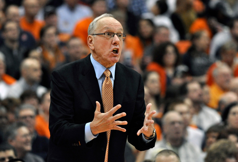 Syracuse coach Jim Boeheim gestures during the second half against Detroit in an NCAA college basketball game in Syracuse, N.Y., Monday, Dec. 17, 2012. Syracuse won 72-68 for Boeheim's 900th career victory. (AP Photo/Kevin Rivoli)