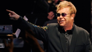 Elton John gestures to the crowd during his joint concert with Leon Russell at the Hollywood Palladium in Los Angeles, Wednesday, Nov. 3, 2010. (AP / Chris Pizzello)