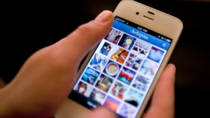 Instagram is demonstrated on an iPhone in this April 2012 photo. (AP / Karly Domb Sadof)