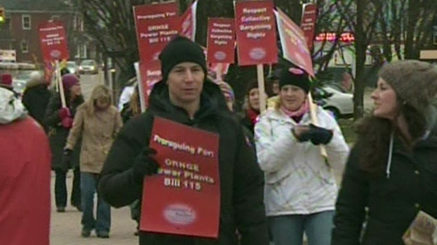 Teachers protest at Erb Street West and Fischer-Hallman Road in Waterloo, Ont., as part of one-day strike action on Tuesday, Dec. 18, 2012. (CTV Kitchener)