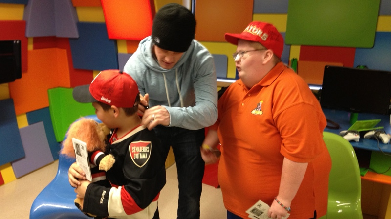 Children at CHEO gets autographs from Senators