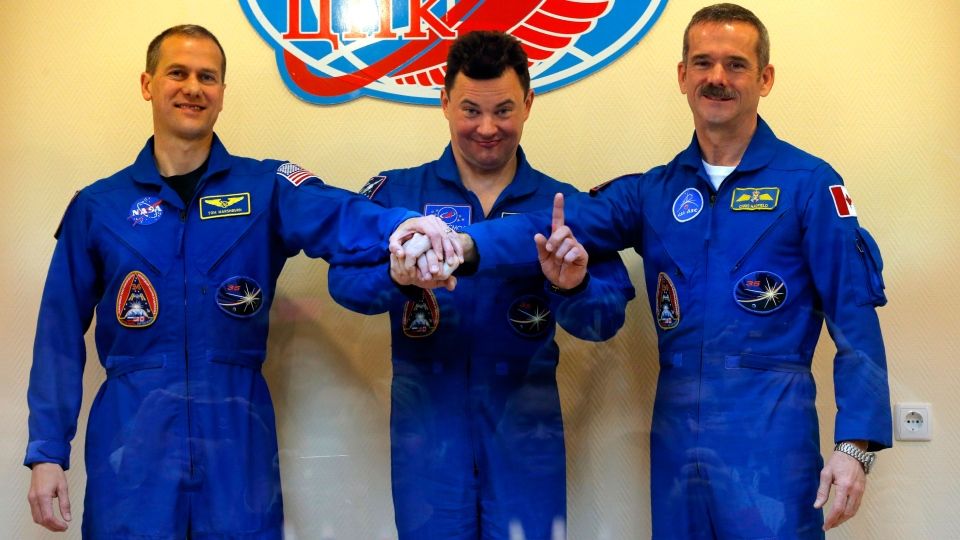 U.S. astronaut Thomas Marshburn, left, Russian cosmonaut Roman Romanenko, center, and Canadian astronaut Chris Hadfield, members of the next mission to the International Space Station, pose for the media after a news conference in the Russian leased Baikonur cosmodrome, Kazakhstan, Tuesday, Dec. 18, 2012. (AP / Dmitry Lovetsky)