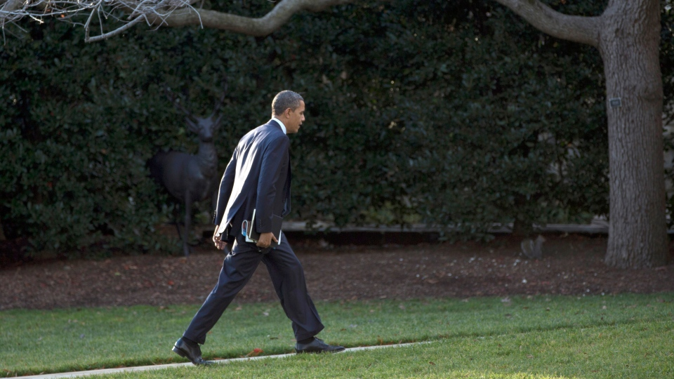 President Barack Obama walks to the Oval Office of the White House in Washington, Tuesday, Dec. 18, 2012. (AP / Carolyn Kaster)