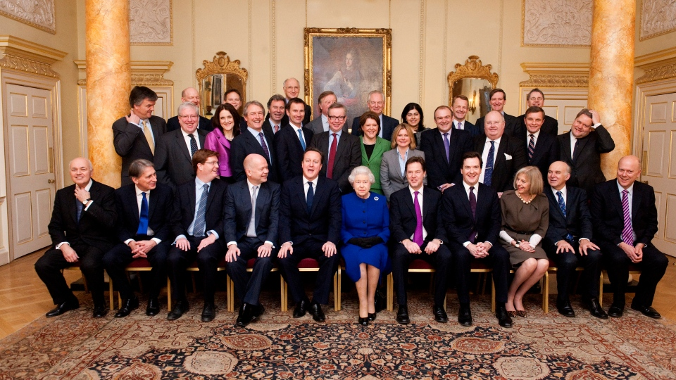 Queen Elizabeth II and members of the Cabinet pose for a group photograph in The Pillared Room, at 10 Downing Street in London, Tuesday, Dec. 18, 2012. (AP  /Jeremy Selwyn, Pool)