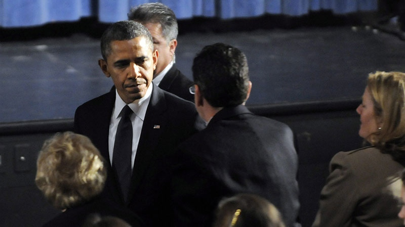 President Barack Obama greets Gov. Dannel Malloy during his arrival at the start of an interfaith vigil for the victims of the Sandy Hook Elementary School shooting on Sunday, Dec. 16, 2012 at Newtown High School in Newtown, Conn. (AP / The Hartford Courant, Stephen Dunn, Pool)