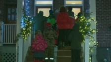 Christmas carollers at doorstep