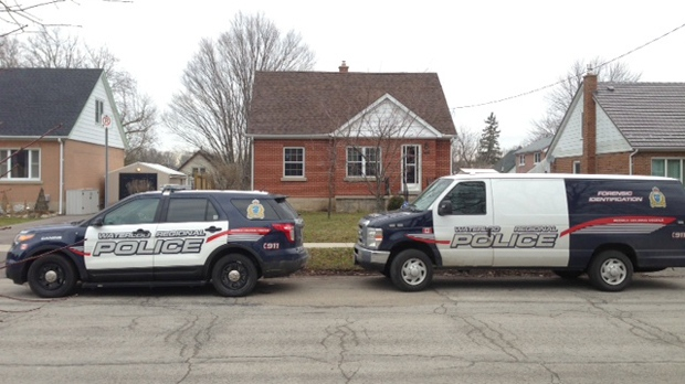 Police cars in front of a home on Elizabeth Drive in Kitchener, Ont., on Wednesday, Dec. 19, 2012. (Brian Dunseith / CTV Kitchener)