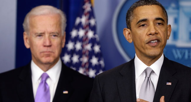 President Barack Obama stands with Vice President Joe Biden as he makes a statement Wednesday, Dec. 19, 2012, in the Brady Press Briefing Room at the White House in Washington, about policies he will pursue following the massacre at Sandy Hook Elementary School in Newtown, Ct. (AP Photo/Charles Dharapak)