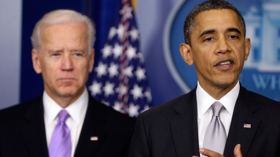 U.S. President Barack Obama stands with Vice President Joe Biden as he makes a statement in the Brady Press Briefing Room at the White House in Washington, Wednesday, Dec. 19, 2012. (AP / Charles Dharapak)