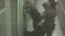 Special Const. Melanie Morris (left) is seen kicking a homeless man who was dragged into a prison cell.