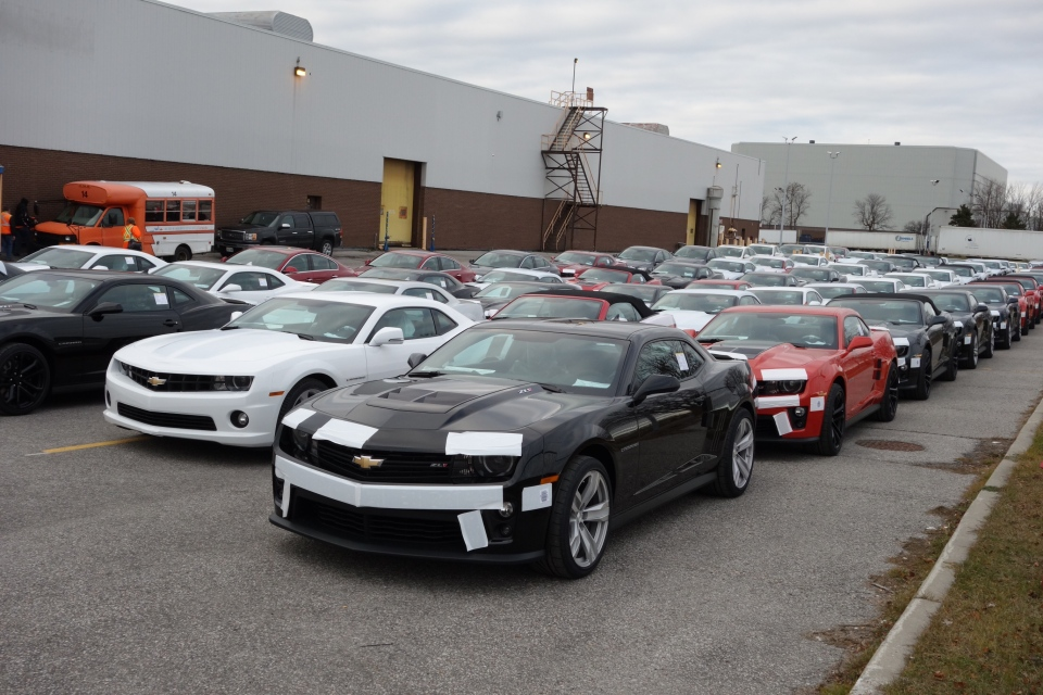 New Chevy Camaros sit parked oustide GM's Oshawa Assembly Plant on Wednesday, Dec. 19, 2012. (Tom Podolec / CTV Toronto)