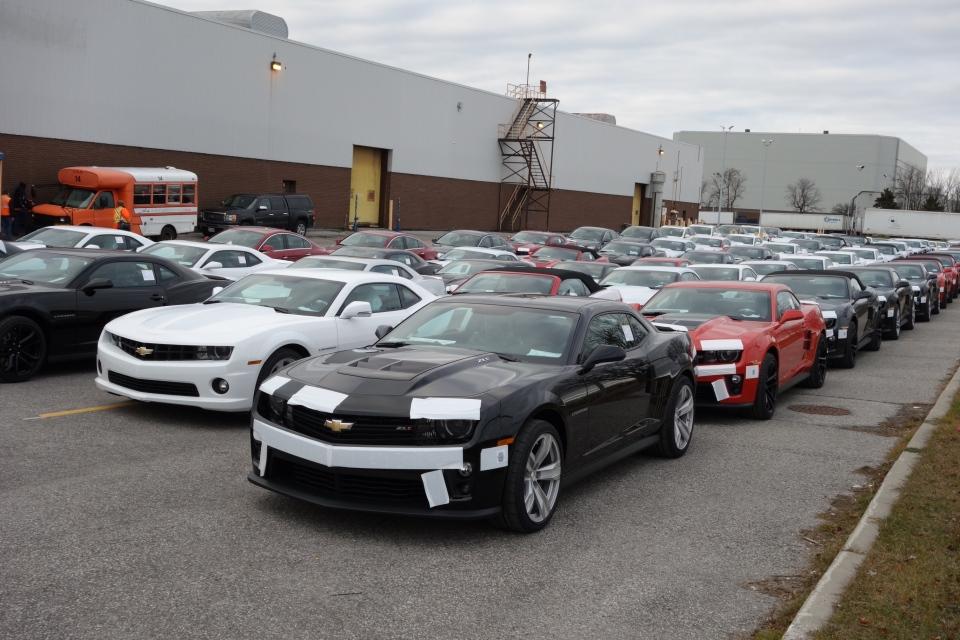 New Chevy Camaros sit parked oustide GM's Oshawa Assembly Plant on Wednesday, Dec. 19, 2012. (Tom Podolec / CTV Toronto)