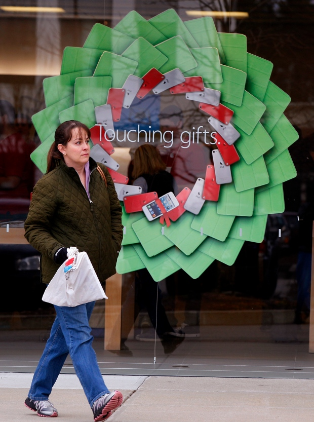 Woman walks past holiday display in Mass. 2012