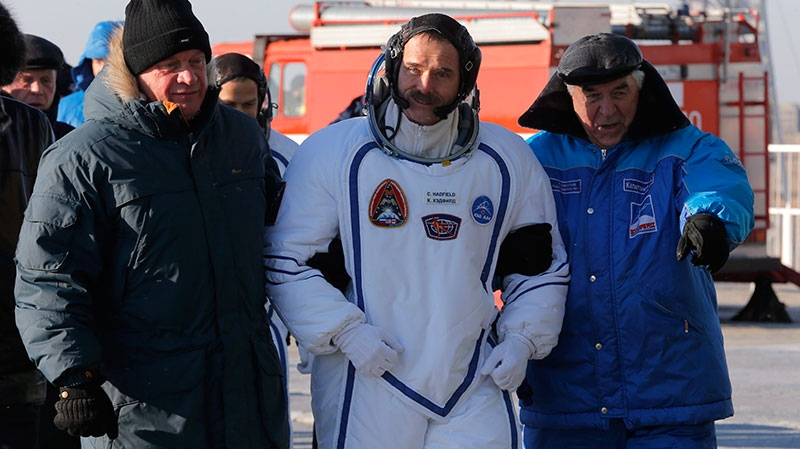 Canadian astronaut Chris Hadfield walks to the rocket prior the launch of Soyuz-FG rocket at the Russian leased Baikonur cosmodrome, Kazakhstan, Wednesday, Dec. 19, 2012. (AP / Dmitry Lovetskyl)