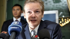 In this Nov. 4, 2010 file photo, Wikileaks founder Julian Assange speaks during a news conference at the Geneva press club, in Geneva, Switzerland. (AP / Keystone, Martial Trezzini)