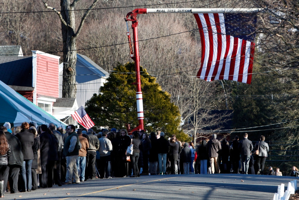 Mourners line up to enter the calling hours for Sandy Hook Elementary School principal Dawn Lafferty Hochsprung on Dec. 19, 2012, in Woodbury, Conn. (AP Photo/Jason DeCrow)