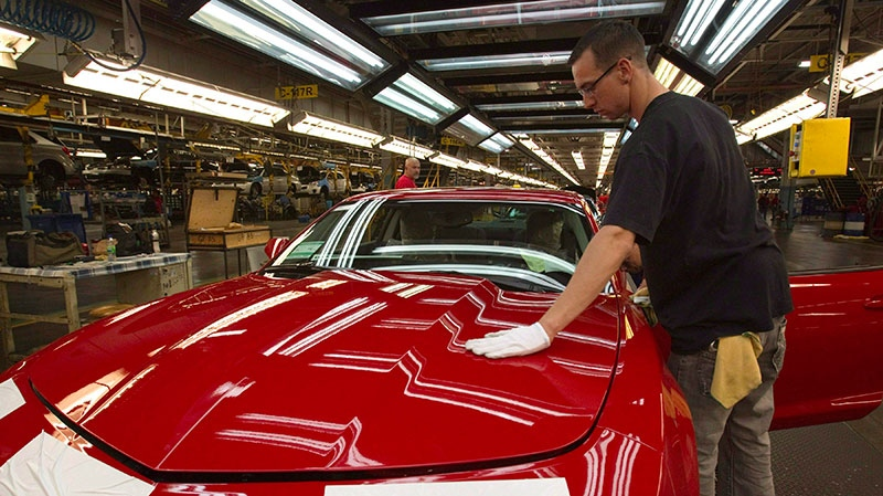 A worker checks the paint on a Camaro at the GM factory in Oshawa, Ontario, Friday, June 10, 2011. (Frank Gunn / THE CANADIAN PRESS)