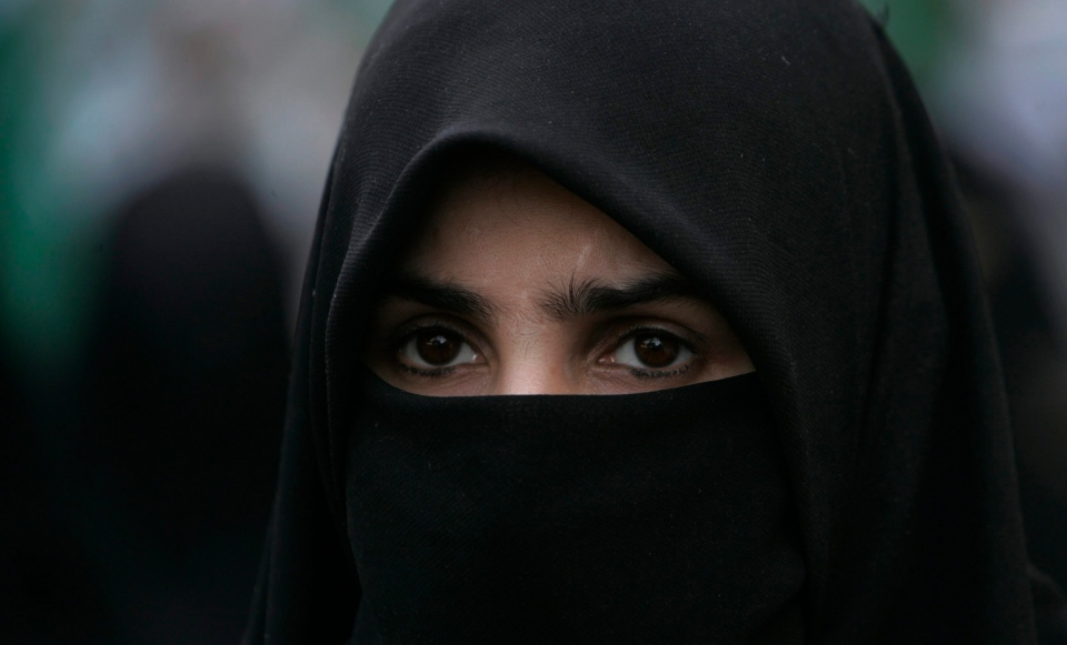 The Supreme Court of Canada has ruled that a woman can wear a religious veil across her face while testifying in court -- but only in certain circumstances. (AP / Shakil Adil)