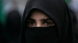 A woman is showing wearing a niqab in this 2011 file photo. (AP / Shakil Adil)